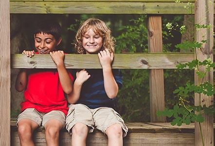 happy boys on a deck