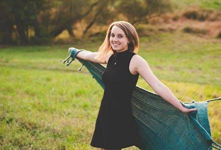 teen in green field